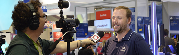 David Spark interviewing a conference attendee